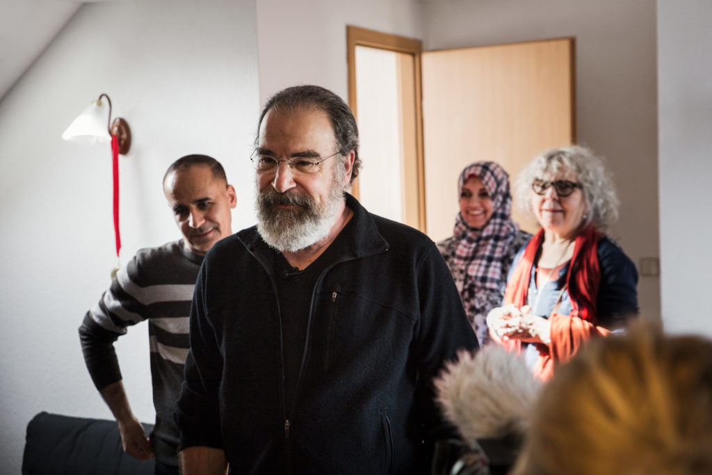 International Rescue Committee ambassador, and actor, Mandy Patinkin, reconnects with a Syrian refugee family.
